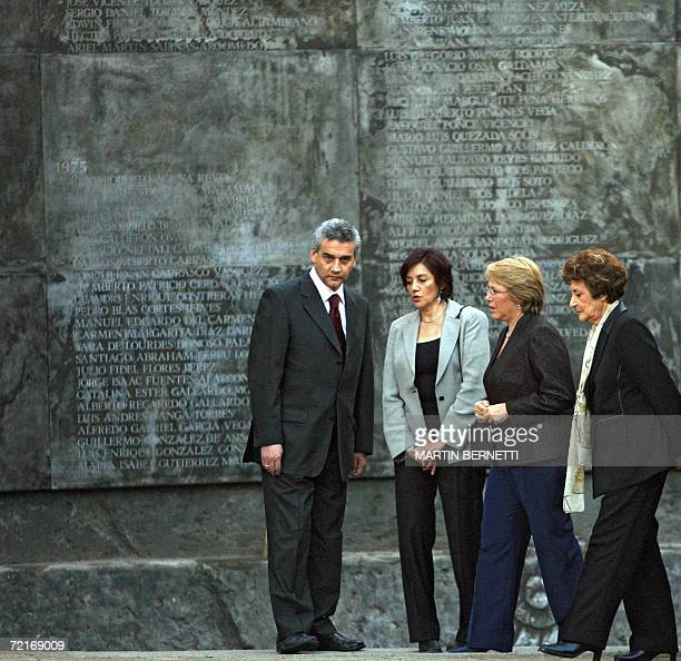 Chilean President Michelle Bachelet walks 14 October 2006 next to her mother Angela Jeria Rodrigo Del Villar and Margarita Romero along the memorial...
