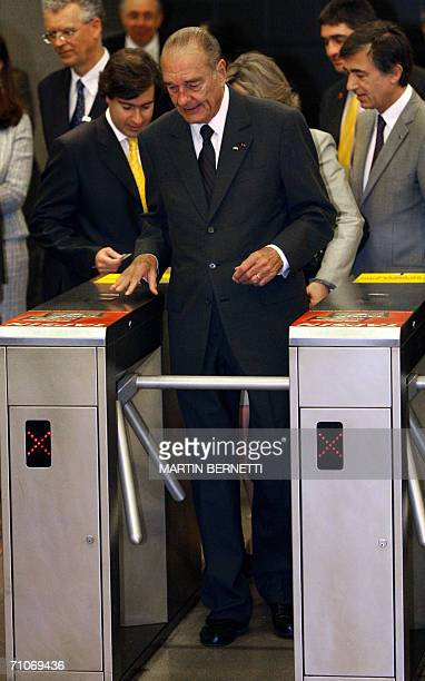 French president Jacques Chirac visits the underground station of Quinta Normal, part of Santiago's largely French-built metro network, with her...