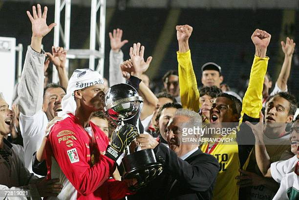 Mexico's Pachuca goalkeeper Miguel Angel Calero kisses the trophy after defeating Chile's Colo Colo in their Copa Sudamericana final match held in...