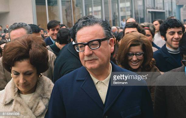Salvador Allende arriving at schoolhouse with his wife Hortensia surrounded by a crowd September 4 1970