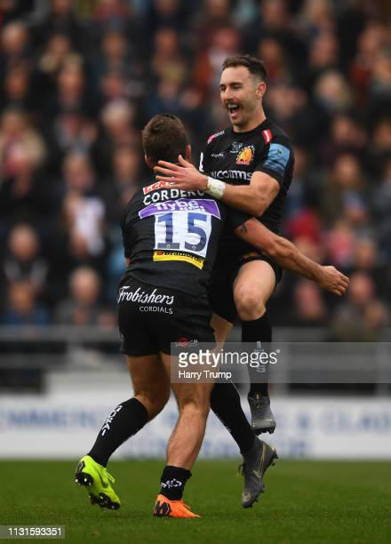 Santiago Cordero of Exeter Chiefs celebrates his sides first try with Nic White of Exeter Chiefs during the Gallagher Premiership Rugby match between...