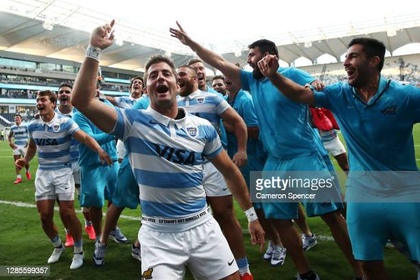 Santiago Cordero of the Pumas celebrates with team mates after winning the 2020 Tri-Nations rugby match between the New Zealand All Blacks and the...