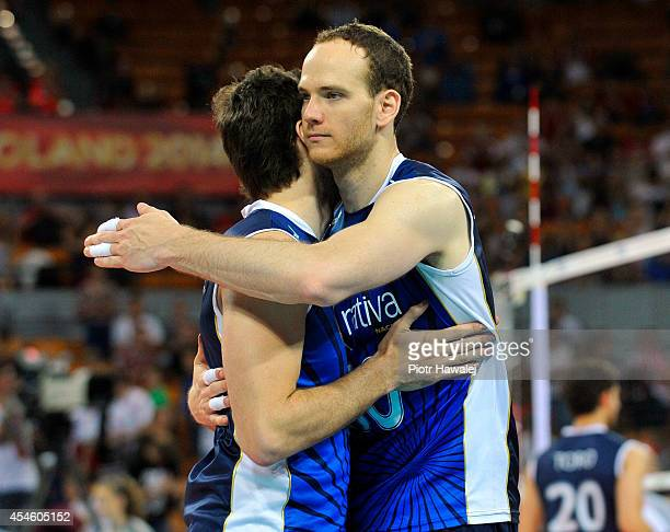 Santiago Darraidou and Jose Luis Gonzalez of Argentina celebrate after winning the match against Cameroon during the FIVB World Championships on...