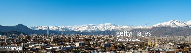 santiago de chile with the snowy andes as background - santiago chile stock pictures, royalty-free photos & images
