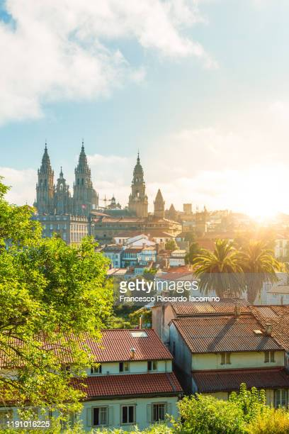santiago de compostela cathedral at sunrise, park and sunny sky, copy space. galicia, spain - santiago de compostela stock pictures, royalty-free photos & images