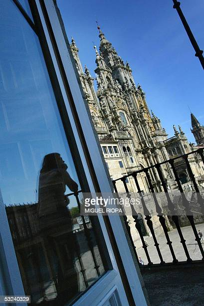 TO GO WITH AFP STORY 'ENTERTAINMENTSPAINPARADORS' A woman looks out onto Obradoiro Square and the Santiago Cathedral from from the balcony of the...