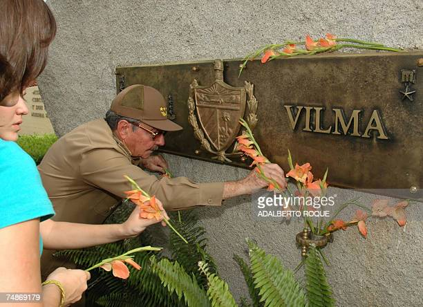 Cuba's acting President Raul Castro places flowers at the grave with the funerary urn containing the ashes his late wife Vilma Espin 22 June 2007 in...