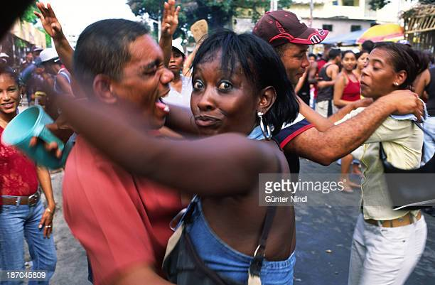 CONTENT] Santiago de Cuba Cuba July 24 2007 Cuban couples dance on the street during carnival time in Santiago de Cuba Carnival in Santiago de Cuba...