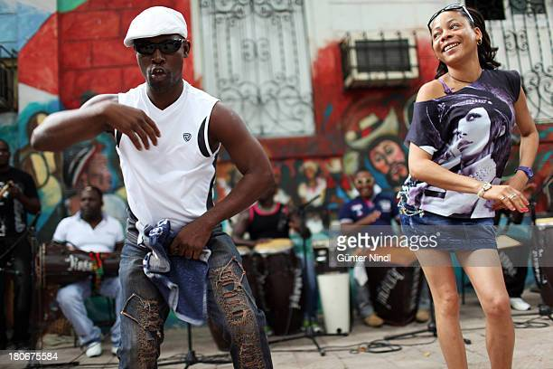 Santiago de Cuba, Cuba, July 9, 2012. Cuban couple dancing Guaguancó in the Casa del Caribe in Santiago. Rumba is a family of musical rhythms and...