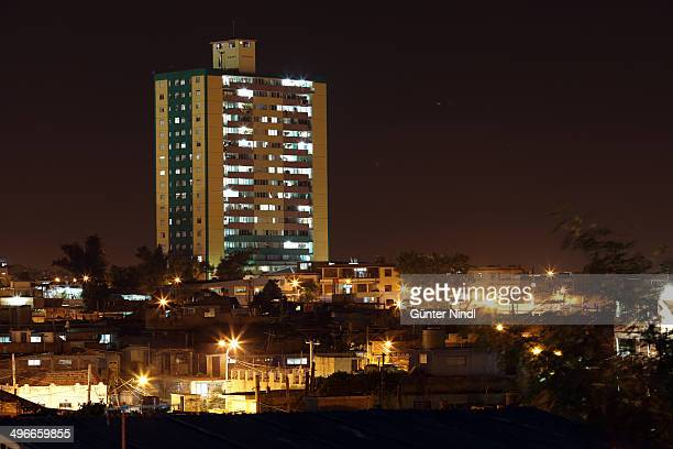 CONTENT] Santiago de Cuba July 25 2013 Night view of the 18plantasMartí building in Santiago de Cuba one day before the celebrations of the 60th...