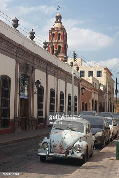 Santiago de Queretaro street view with beetle, Mexico