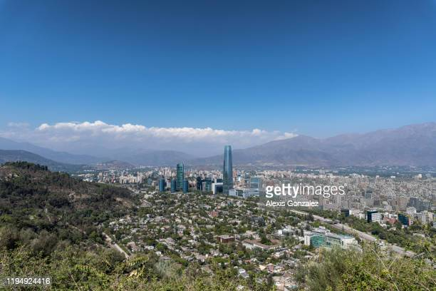 santiago financial district from san cristobal hill - santiago chile stock pictures, royalty-free photos & images
