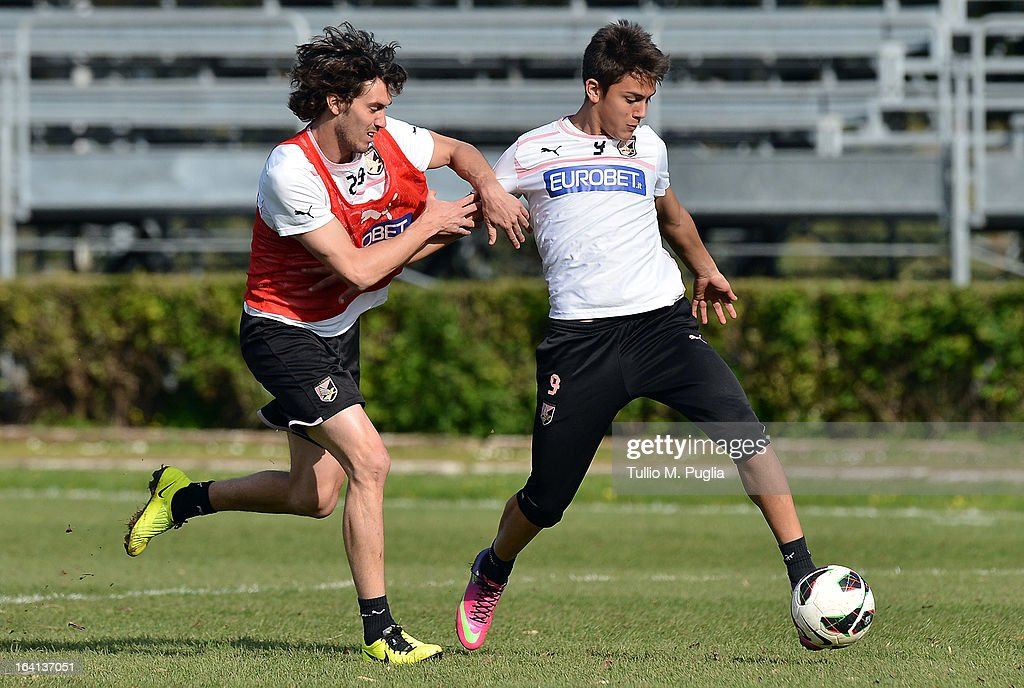 Santiago Garcia (L) and Paulo Dybala in action during a Palermo training session at Tenente Carmelo Onorato Sports Center on March 20, 2013 in Palermo, Italy.