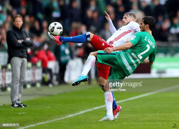 Santiago Garcia of Bremen and Aaron Hunt of Hamburg battle for the ball during the Bundesliga match between Werder Bremen and Hamburger SV at...