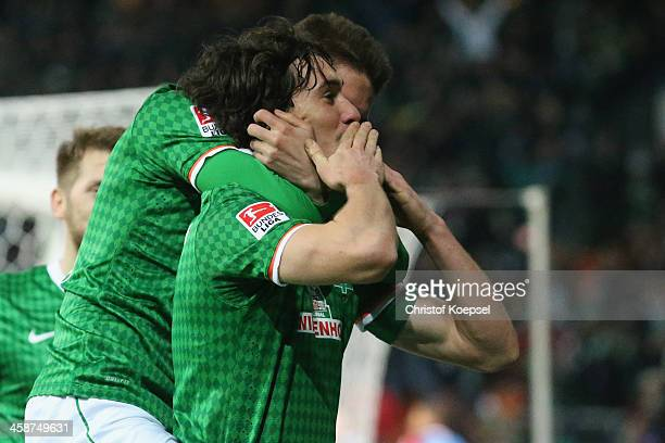 Santiago Garcia of Bremen celebrates the first goal weith Luca Caldirola during the Bundesliga match between Werder Bremen and Bayer Leverkusen at...