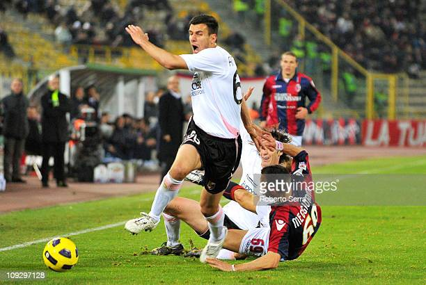 Santiago Garcia of Palermo fouls Riccardo Meggiorini of Bologna before receiving a red card during the Serie A match between Bologna and Palermo at...