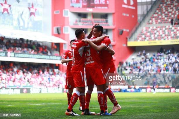 Santiago Garcia of Toluca celebrates with teammates after scoring the first goal of his team during the 2nd round match between Toluca and Puebla as...
