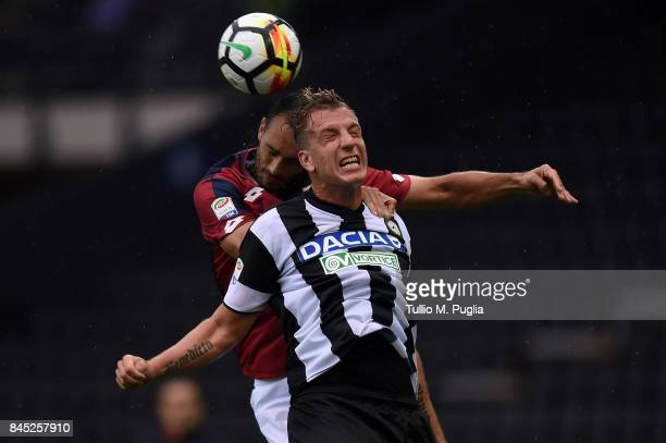 Santiago Gentiletti of Genoa and Maxi Lopez of Udinese compete for a header during the Serie A match between Udinese Calcio and Genoa CFC at Stadio...