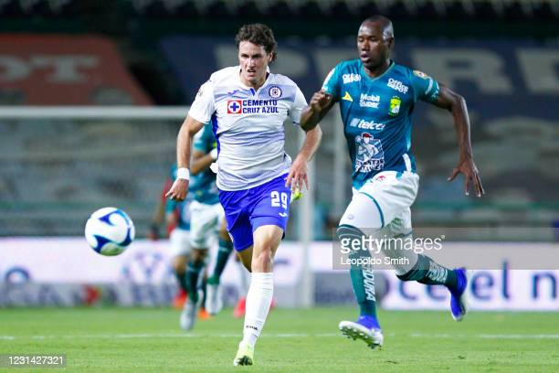 Santiago Gimenez of Cruz Azul competes for the ball with Andres Mosquera of Leon during the 8th round match between Leon and Cruz Azul as part of the...
