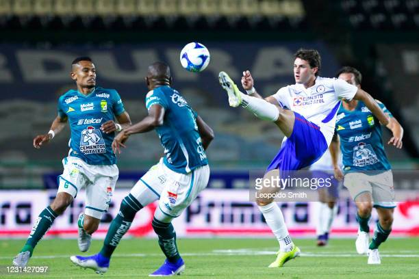 Santiago Gimenez of Cruz Azul competes for the ball with William Tesillo and Andres Mosquera of Leon during the 8th round match between Leon and Cruz...