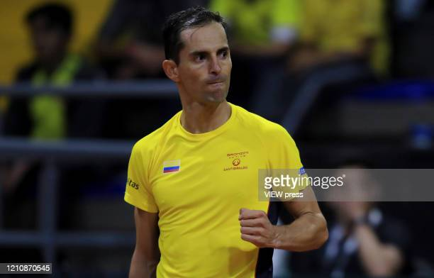 Santiago Giraldo of Colombia celebrates a point against Juan Londero of Argetina during the game 2 of their Copa Davis 2020 in Bogota Colombia on...