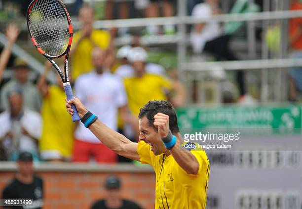 Santiago Giraldo of Colombia celebrates after defeating Taro Daniel of Japan during the Davis Cup World Group Playoff singles match between Santiago...