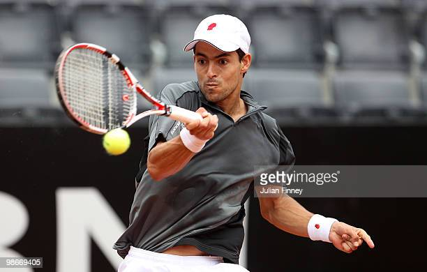 Santiago Giraldo of Colombia celebrates plays a forehand in his match against Juan Carlos Ferrero of Spain during day two of the ATP Masters Series -...