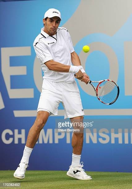 Santiago Giraldo of Colombia hits a backhand shot during his Men's Singles first round match against Jesse Levine of Canada on day one of the AEGON...