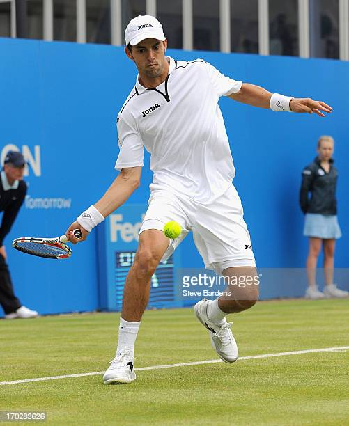 Santiago Giraldo of Colombia hits a forehand shot during his Men's Singles first round match against Jesse Levine of Canada on day one of the AEGON...