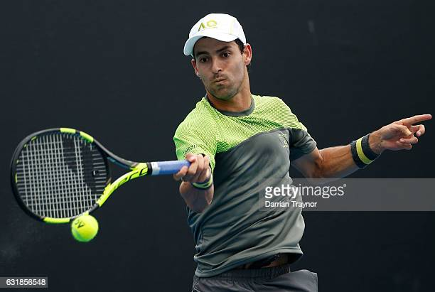 Santiago Giraldo of Colombia plays a forehand during his first round match against Kyle Edmund of Great Britain on day two of the 2017 Australian...