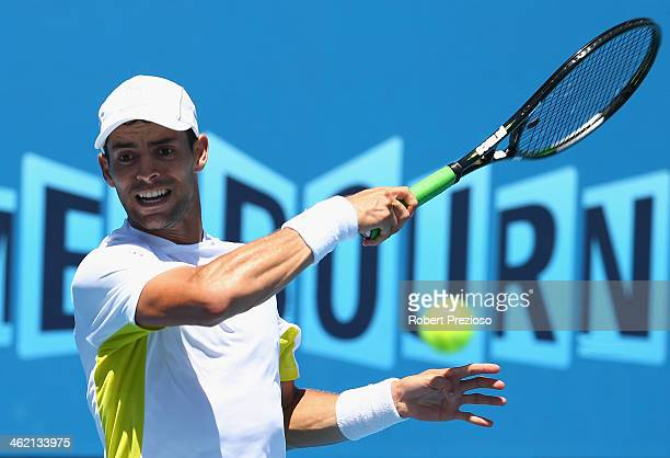 Santiago Giraldo of Colombia plays a forehand in his first round match against Sam Querrey of the United States during day one of the 2014 Australian...