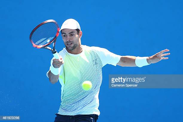 Santiago Giraldo of Colombia plays a forehand in his second round match against Steve Johnson of the United States during day four of the 2015...