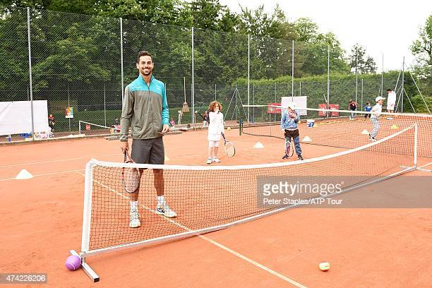 Santiago Giraldo of Colombia plays mini tennis at Kids Day at the Geneva Open Parc des EauxVives on May 20 2015 in Geneva Switzerland