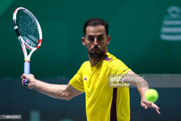 Santiago Giraldo of Colombia returns a forehand against Steve Darcis of Belgium during Day 1 of the 2019 Davis Cup at La Caja Magica on November 18,...
