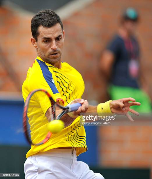 Santiago Giraldo of Colombia returns a forehand shot during the Davis Cup World Group Playoff singles match between Santiago Giraldo of Colombia and...