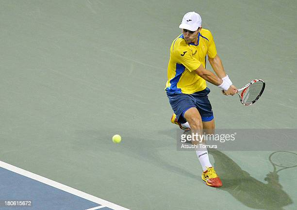 Santiago Giraldo of Colombia returns a shot in the singles game against Kei Nishikori of Japan during day three of the Davis Cup World Group Play-Off...