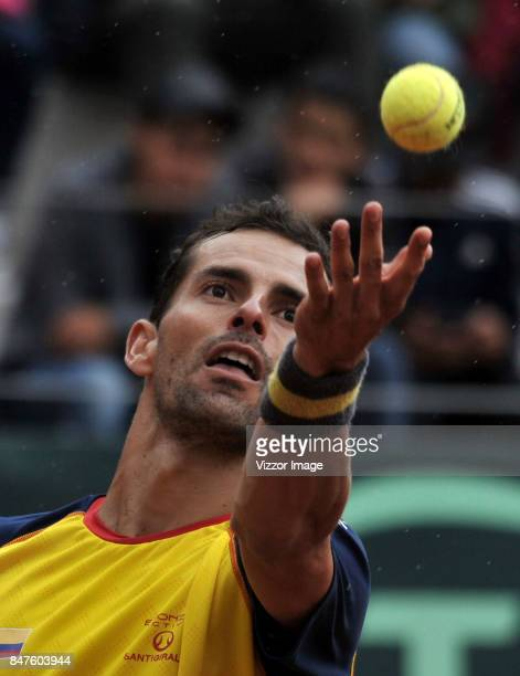 Santiago Giraldo of Colombia serves during a match against Franko Skugor de Croacia as part of Davis Cup at La Santamaria Ring Bull on September 15...