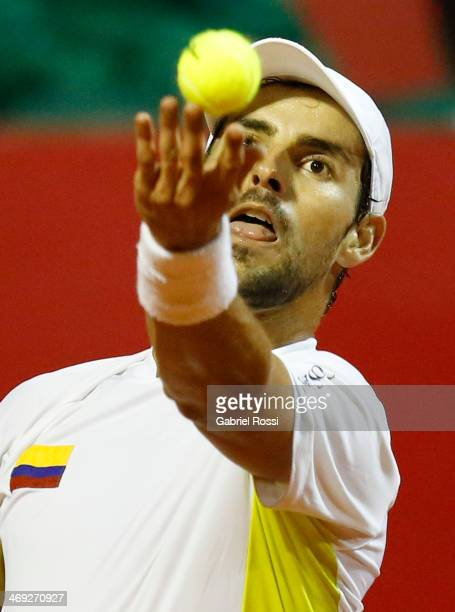 Santiago Giraldo of Colombia serves during a tennis match between David Ferrer and Santiago Giraldo as part of ATP Buenos Aires Copa Claro on...