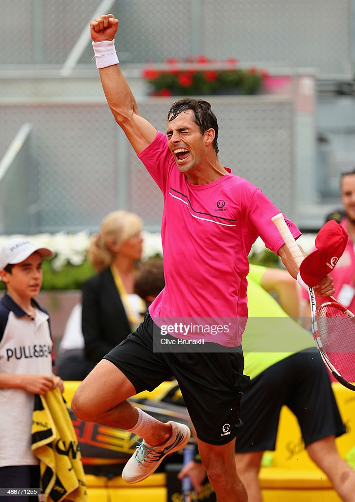 Santiago Giraldo of Columbia celebrates after his straight sets victory against Andy Murray of Great Britain in their third round match during day six of the Mutua Madrid Open tennis tournament at the Caja Magica on May 8, 2014 in Madrid, Spain.