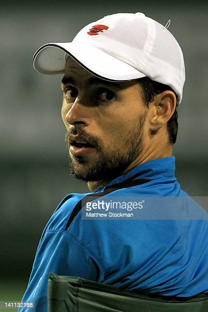 Santiago Giraldo of Columbia cools down between games while playing Kei Nishikori of Japan during the BNP Paribas Open at the Indian Wells Tennis...