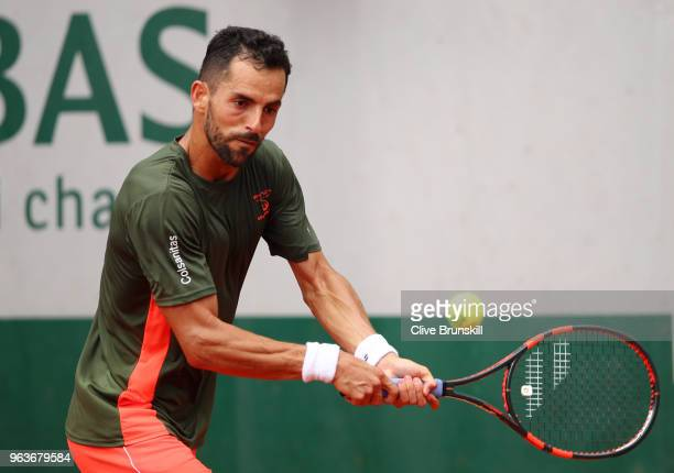 Santiago Giraldo of Columbia plays a backhand during the mens singles seonc round match against Roberto Bautista Agut of Spain during day four of the...