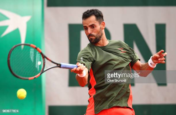 Santiago Giraldo of Columbia plays a forehand during the mens singles seonc round match against Roberto Bautista Agut of Spain during day four of the...