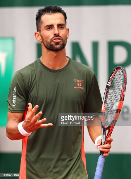 Santiago Giraldo of Columbia reacts during the mens singles seonc round match against Roberto Bautista Agut of Spain during day four of the 2018...