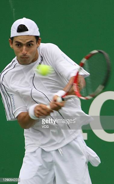Santiago Giraldo of Columbia returns a ball to Jurgen Melzer of Australia during day three of the 2011 Shanghai Rolex Masters at the Qi Zhong Tennis...