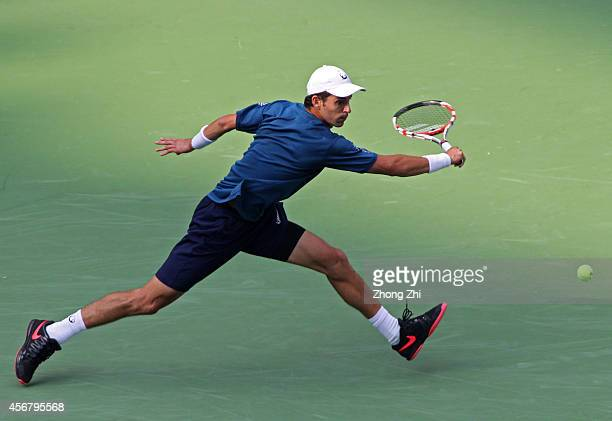 Santiago Giraldo of Columbia returns a shot during his match against Vasek Pospisil of Canada during the day 3 of the Shanghai Rolex Masters at the...