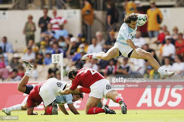 Santiago Gomez Cora of Argentina jumps over the defence during the pool match between Argentina and Portugal during round six of the IRB Sevens World...