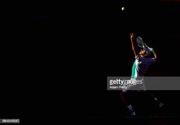 Santiago Gonzalez of Mexico partner of Donald Young of The United States serves during the mens doubles final match against ry and Michael Venus of...
