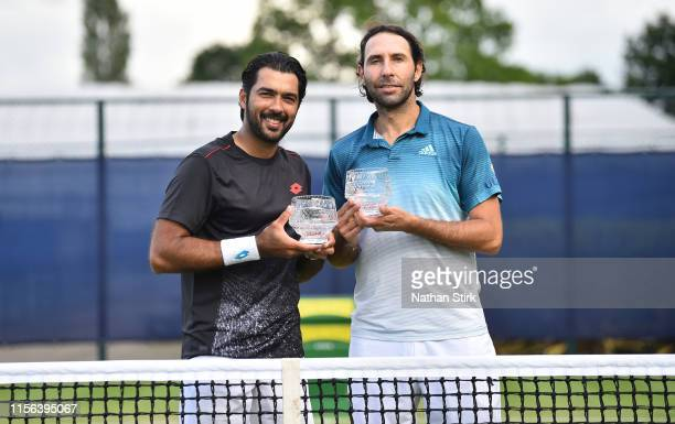 Santiago González of Mexico and AisamulHaq Qureshi of Pakistan pose after winning the men's doubles against Zhang Ze and Gong Maoxin of China during...