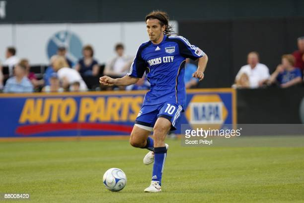 Santiago Hirsig of the Kansas City Wizards passes the ball against Chivas USA during the game at Community America Ballpark on May 23, 2009 in Kansas...