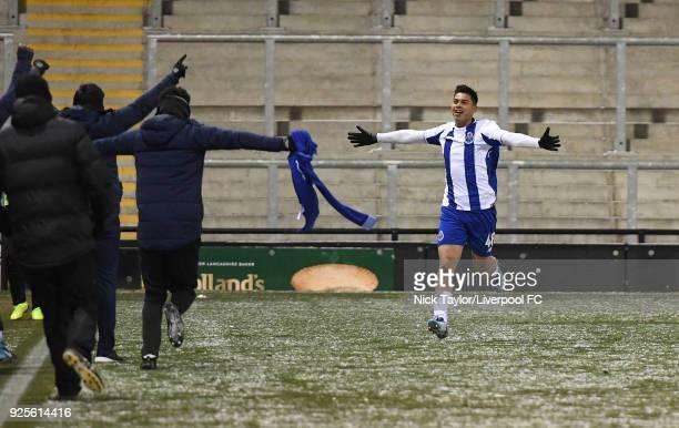 Santiago Irala of Porto runs towards the Porto dugout to celebrate his winning goal during the Liverpool v Porto Premier League International Cup...